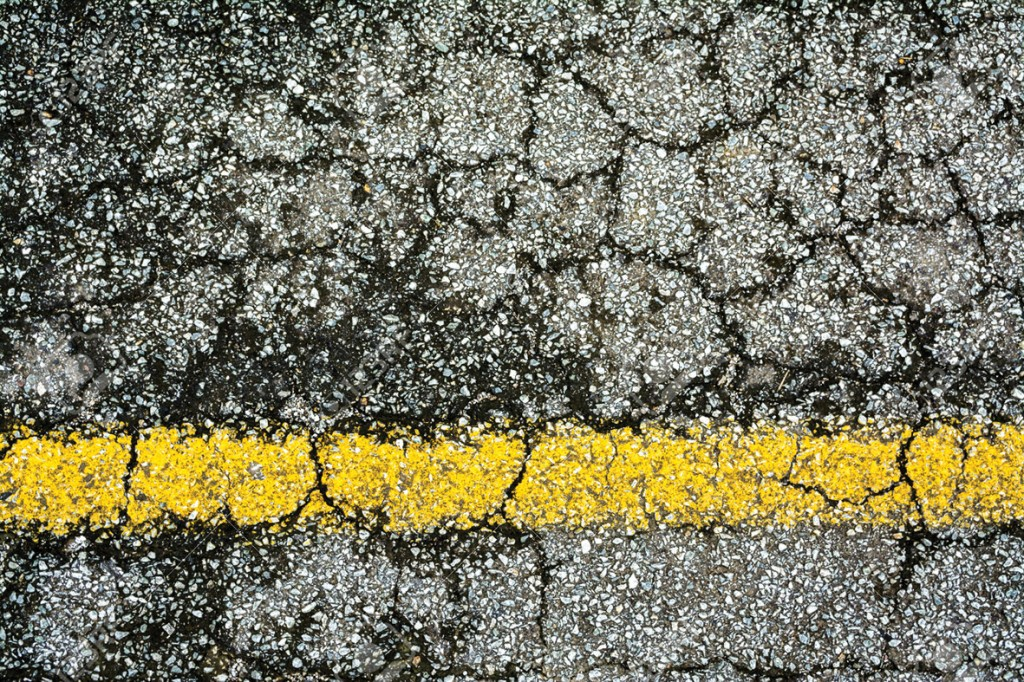 Old yellow line on broken  road texture background