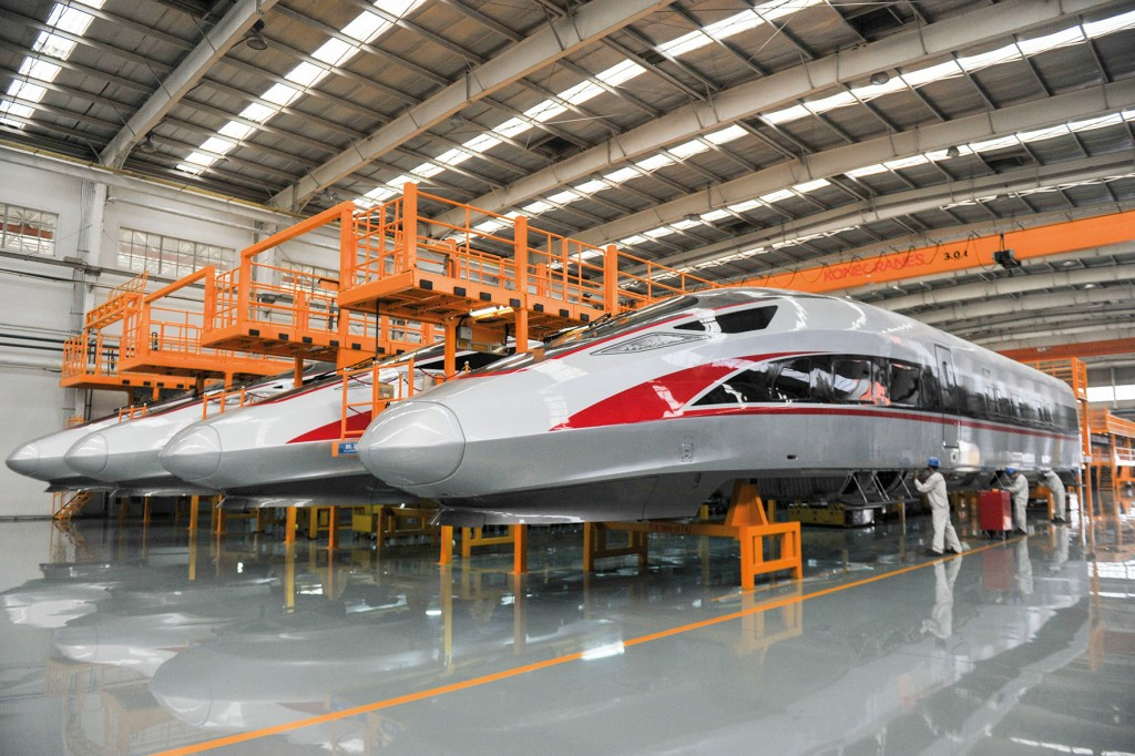 QINGDAO, CHINA - JUNE 08: Working staff assemble China's 'Fuxing' high-speed bullet trains at the manufacturing line of CRRC Qingdao Sifang Co., Ltd. on June 8, 2018 in Qingdao, Shandong Province of China. Located in the Jihongtan Town of Qingdao, CRRC Qingdao Sifang Co., Ltd covers an area of 1.77 million square meters. (Photo by Visual China Group via Getty Images/Visual China Group via Getty Images)