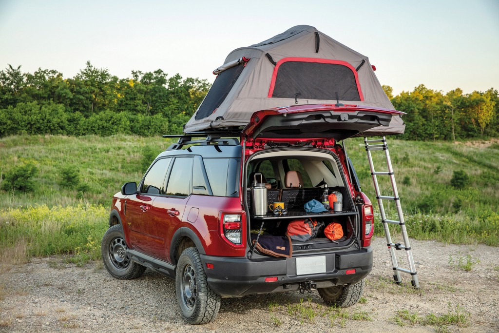 Bronco Sport can quickly help with basecamp setup thanks to an innovative slide-out working table, part of the available five-way configurable Cargo Management System. (Pre-production model pictured.)