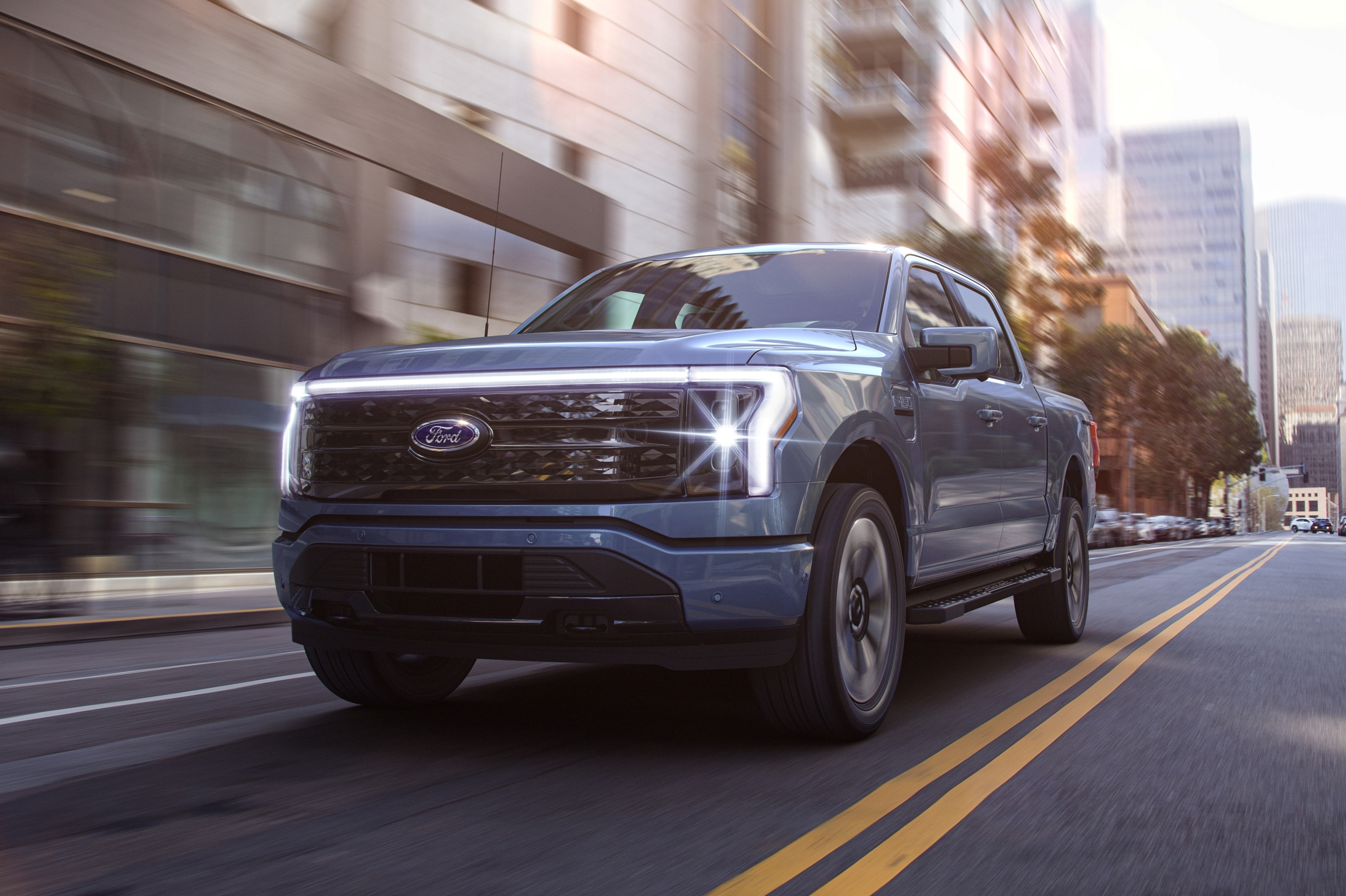 2022 Ford F-150 Lightning Platinum. Pre-production model with available features shown. Available starting spring 2022.